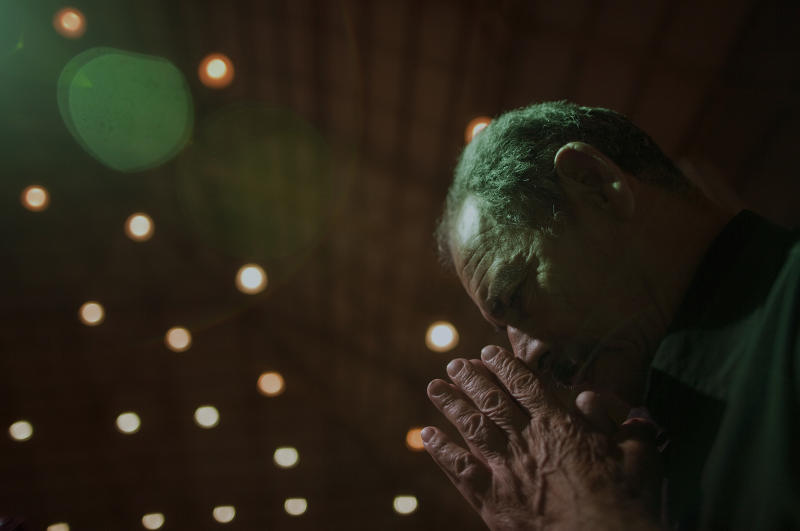 A man prays during a Sunday mass at the Mother of God sanctuary in Sao Paulo, Brazil, Sunday March 3, 2013.  Catholics around the world attended the first Sunday masses since Benedict XVI stepped down as pope. Many prayed for a energetic, new leader to reinvigorate what many said was an ailing institution.(AP Photo/Andre Penner)