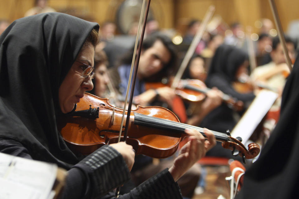 <p> In this picture taken on Tuesday, Nov. 30, 2010, members of the Tehran Symphony Orchestra rehearse at the Roudaki hall in Tehran, Iran. Iran's national symphony orchestra has been disbanded for lack of funds, musicians said, another sign of the effects of Western economic sanctions. Orchestra members told the semiofficial ILNA news agency Monday Oct 29 2012 that they have not rehearsed together and have not been paid for three months(AP Photo/Vahid Salemi) </p>