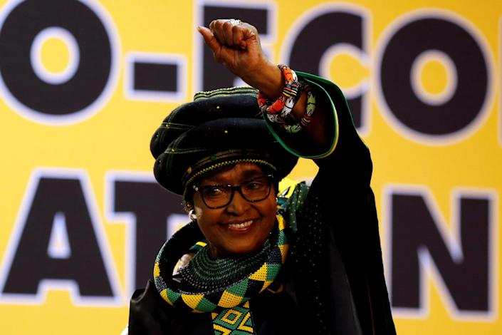 <p>Winnie Madikizela Mandela, ex-wife of former South African president Nelson Mandela, gestures to supporters at the 54th National Conference of the ruling African National Congress in Johannesburg, South Africa, Dec. 16, 2017. (Photo: Siphiwe Sibeko/Reuters) </p>