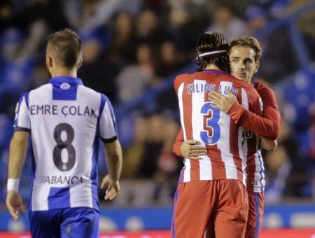 Football Soccer - Deportivo Coruna v Atletico Madrid - Spanish La Liga Santander - Riazor Stadium, A Coruna, Spain,  2/3/17  Atletico Madrid's Antoine Griezmann (R) is congratulated by team mate Filipe Luis after scoring a goal.    REUTERS/Miguel Vidal