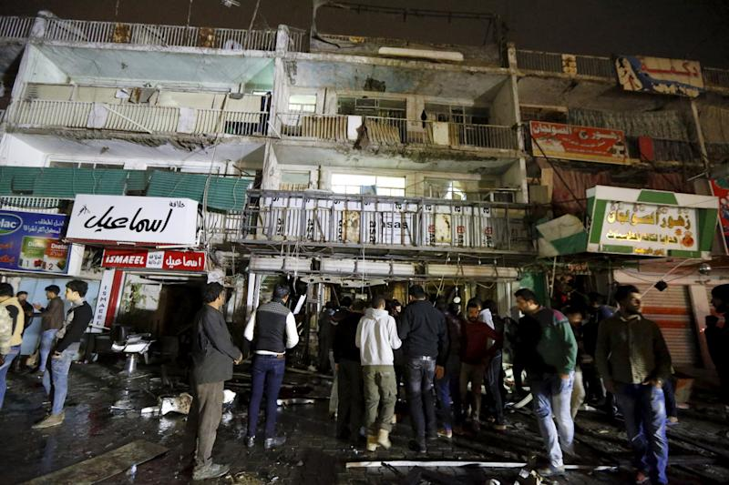 People gather at the site of car bomb in New Baghdad