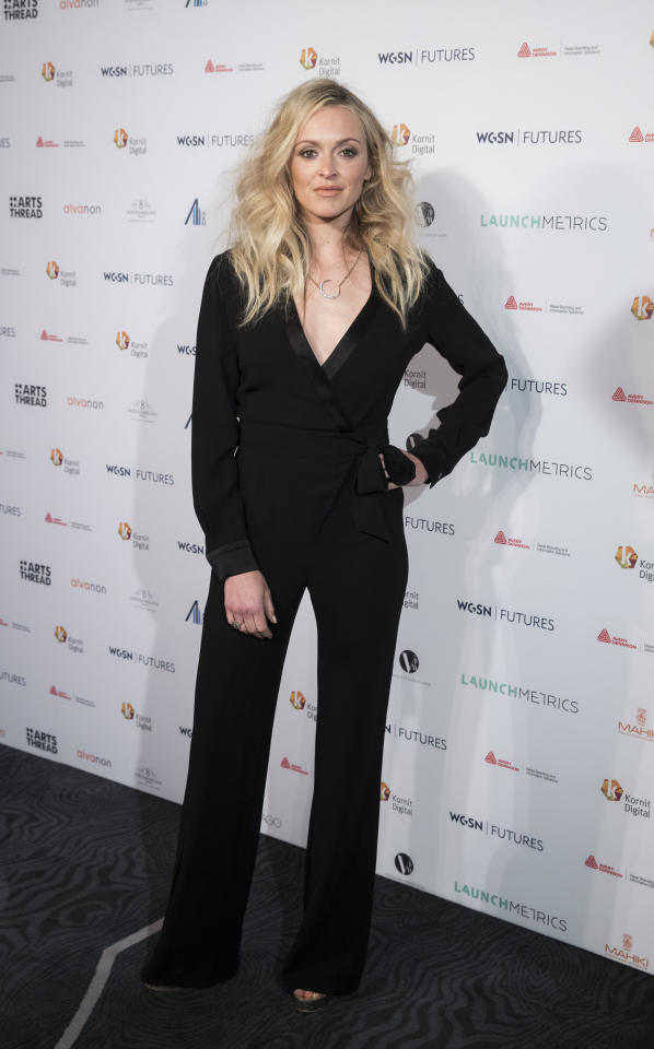 <p>Fearne's worn some out-there looks in the past, but the star always looks on point in a stripped back look like this one. <i>[Photo: Getty Images]</i></p>