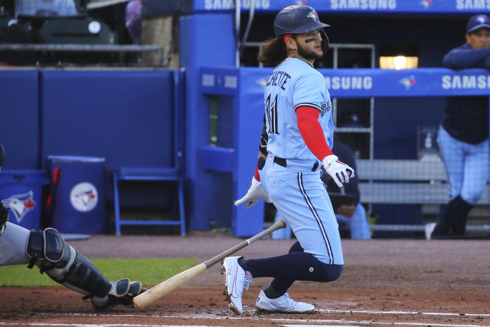 Toronto Blue Jays' Bo Bichette watches his single off Toronto Blue Jays starting pitcher T.J. Zeuch during first the inning of a baseball game Thursday, June 17, 2021, in Buffalo, N.Y. (AP Photo/Jeffrey T. Barnes)
