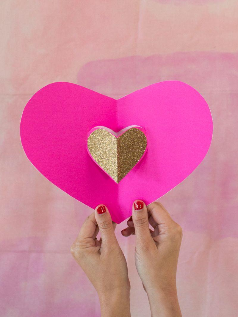 "<p>These pop-up heart cards are a sweet and simple way to spread a little love on Valentine's Day. Use the downloadable template to create your cards on solid, patterned, or glitter paper. </p><p><strong>See more at <a href=""https://ohjoy.com/my_weblog/2015/01/do-something-and-give-love-letters.html"" rel=""nofollow noopener"" target=""_blank"" data-ylk=""slk:Oh Joy!"" class=""link rapid-noclick-resp"">Oh Joy!</a>.</strong></p><p><a class=""link rapid-noclick-resp"" href=""https://go.redirectingat.com?id=74968X1596630&url=https%3A%2F%2Fwww.walmart.com%2Fip%2FArtSkills-ArtSkills-10-Pack-Glitter-Paper-10-sheets%2F462960431&sref=https%3A%2F%2Fwww.thepioneerwoman.com%2Fhome-lifestyle%2Fcrafts-diy%2Fg35084525%2Fdiy-valentines-day-cards%2F"" rel=""nofollow noopener"" target=""_blank"" data-ylk=""slk:SHOP GLITTER PAPER"">SHOP GLITTER PAPER</a></p>"