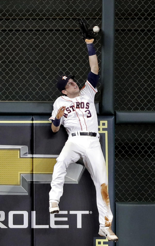 Houston Astros left fielder Kyle Tucker tries to catch a triple by Oakland Athletics' Marcus Semien during the fifth inning of a baseball game Tuesday, July 10, 2018, in Houston. (AP Photo/David J. Phillip)