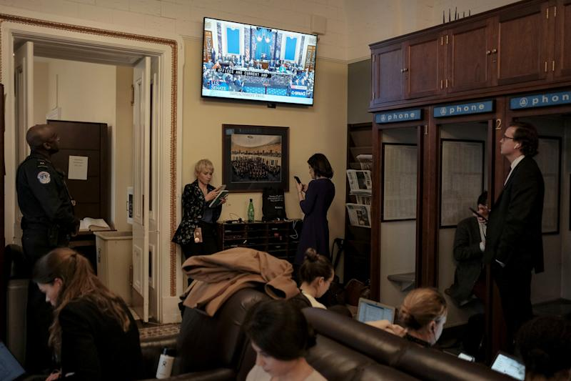 Reporters watch the Senate impeachment vote in the press gallery at the Capitol in Washington, D.C., on Feb. 5, 2020. | Gabriella Demczuk for TIME