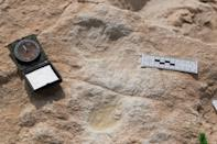 This undated handout photo obtained September 16, 2020 shows the first human footprint discovered at the Alathar ancient lake
