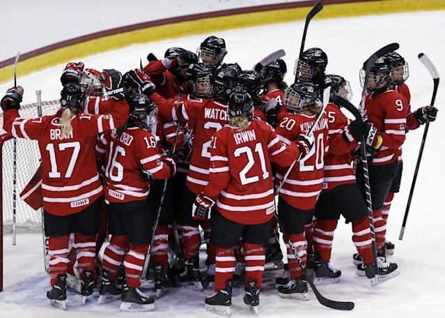 Team Canada players celebrate their 6-3 win over Finland in the Four Nations Cup women's championship hockey game on Saturday, Nov. 9, 2013, in Lake Placid, N.Y. (AP Photo/Mike Groll)