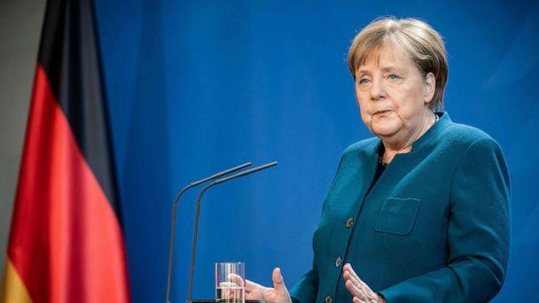 PHOTO: German Chancellor Angela Merkel makes a press statement on the spread of the coronavirus in Berlin, March 22, 2020. Merkel is going in to quarantine after meeting virus-infected doctor according to her spokesman. (Michael Kappeler/AFP/Getty Images)