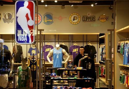 A sales assistant is seen in an NBA Playzone store at a shopping mall in Beijing