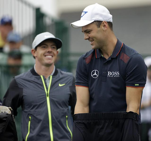 Martin Kaymer, of Germany, right, and Rory McIlroy, of Northern Ireland, arrive on the 10th hole during the second round of the PGA Championship golf tournament at Valhalla Golf Club on Friday, Aug. 8, 2014, in Louisville, Ky. (AP Photo/David J. Phillip)