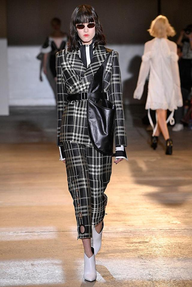 <p>Model wears a plaid pantsuit at the fall 2018 Self-Portrait show. (Photo: Getty Images) </p>