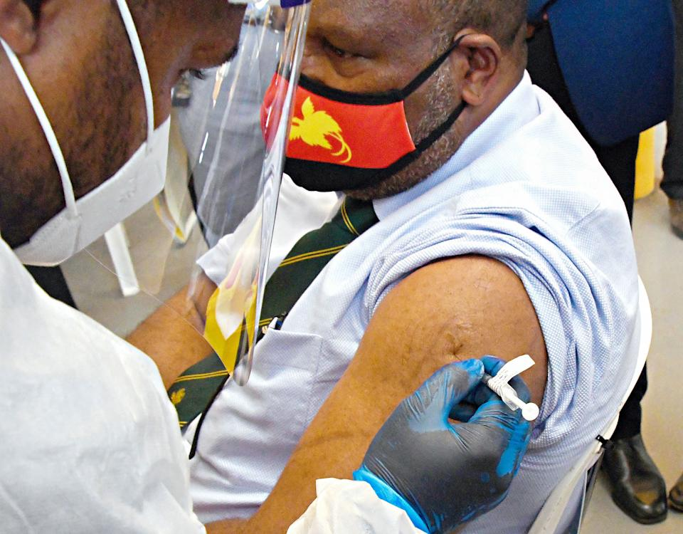 This photo taken on March 30, 2021 shows Papua New Guinea's Prime Minister James Marape receiving a dose of the AstraZeneca Covid-19 vaccine in Port Moresby, as Papua New Guinea's health minister on April 1 called disinformation spread on Facebook the