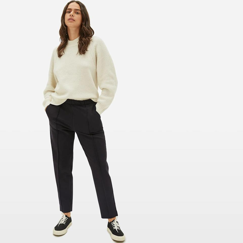 """<h2>Everlane The Dream Pant</h2><br>Wrinkle resistant and business appropriate in appearance (there's pintuck detailing!), you'd never guess these 58% cotton pants are almost as comfortable as your favorite sweatpants. Look sleek and chic when you get to your destination in Everlane's tailored Dream Pant. <br><br><em>Shop <strong><a href=""""https://www.everlane.com/"""" rel=""""nofollow noopener"""" target=""""_blank"""" data-ylk=""""slk:Everlane"""" class=""""link rapid-noclick-resp"""">Everlane</a></strong></em><br><br><strong>Everlane</strong> The Dream Pant, $, available at <a href=""""https://go.skimresources.com/?id=30283X879131&url=https%3A%2F%2Fwww.everlane.com%2Fproducts%2Fwomens-live-in-pant-black%3Fcollection%3Dwomens-bottoms"""" rel=""""nofollow noopener"""" target=""""_blank"""" data-ylk=""""slk:Everlane"""" class=""""link rapid-noclick-resp"""">Everlane</a>"""