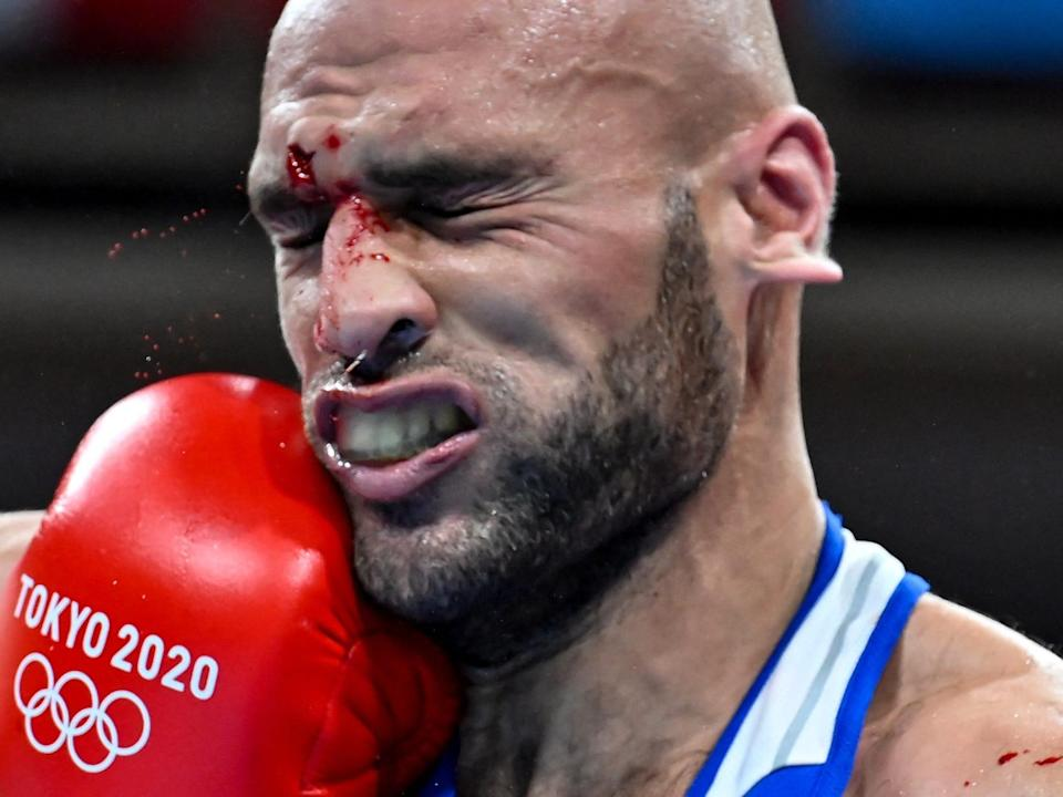 A Jordan boxer takes a punch to the face in the Tokyo Olympics.