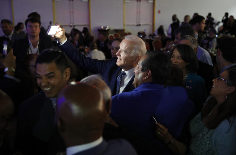 Democratic presidential candidate Former Vice President Joe Biden takes a selfie at the Clark County Democratic Party 'Kick-Off to Caucus 2020' event, Saturday, Feb. 15, 2020, in Las Vegas. (AP Photo/John Locher)