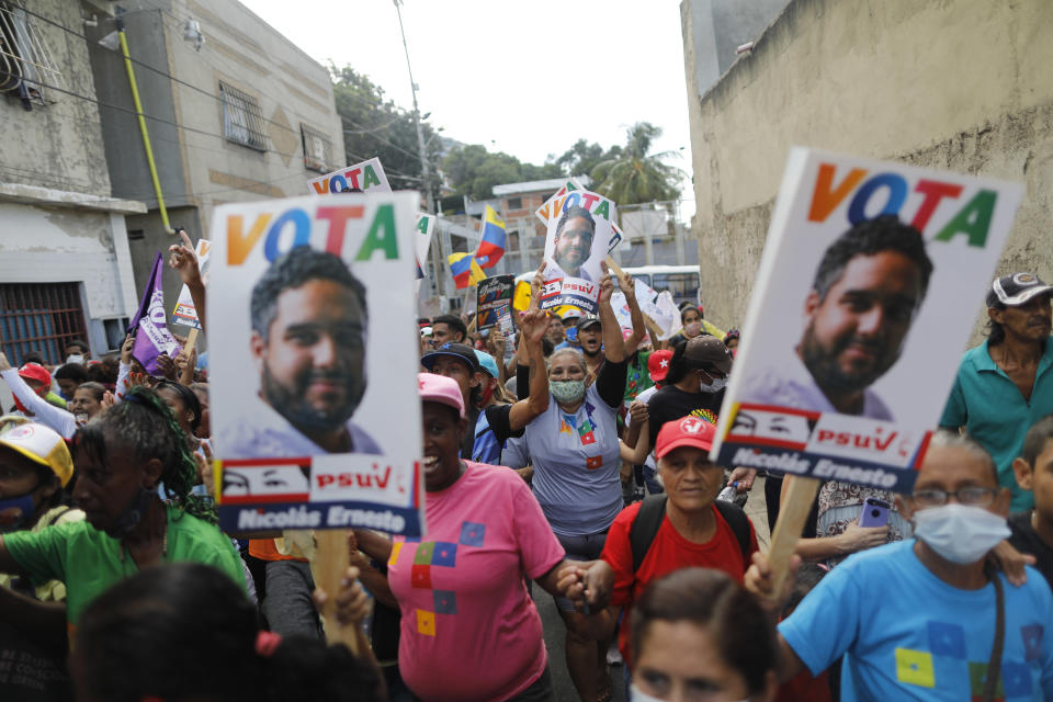 Supporters of Nicolas Maduro Guerra, son of Venezuela's President Nicolas Maduro, participate in a political rally to show their support, as the President's son campaigns for a spot in the National Assembly for the upcoming Dec. 6 midterm elections, Sunday, Nov. 29, 2020. (AP Photo/Ariana Cubillos)