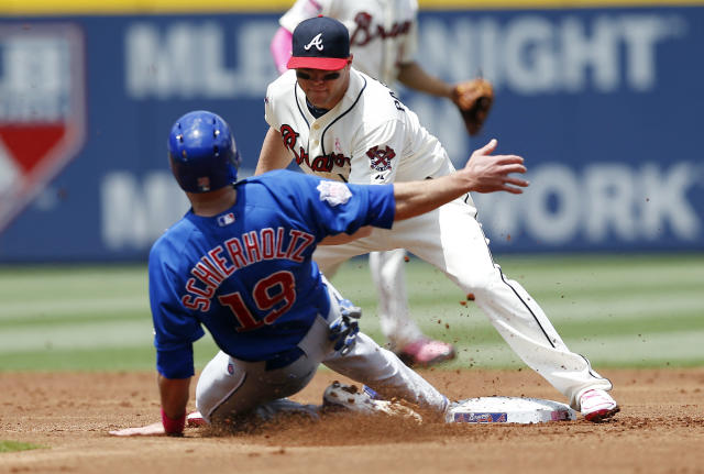 Chicago Cubs' Nate Schierholtz (19) is tagged out by Atlanta Braves second baseman Tyler Pastornicky while trying to steal second base in the second inning of a baseball game on Sunday, May 11, 2014, in Atlanta. (AP Photo/John Bazemore)