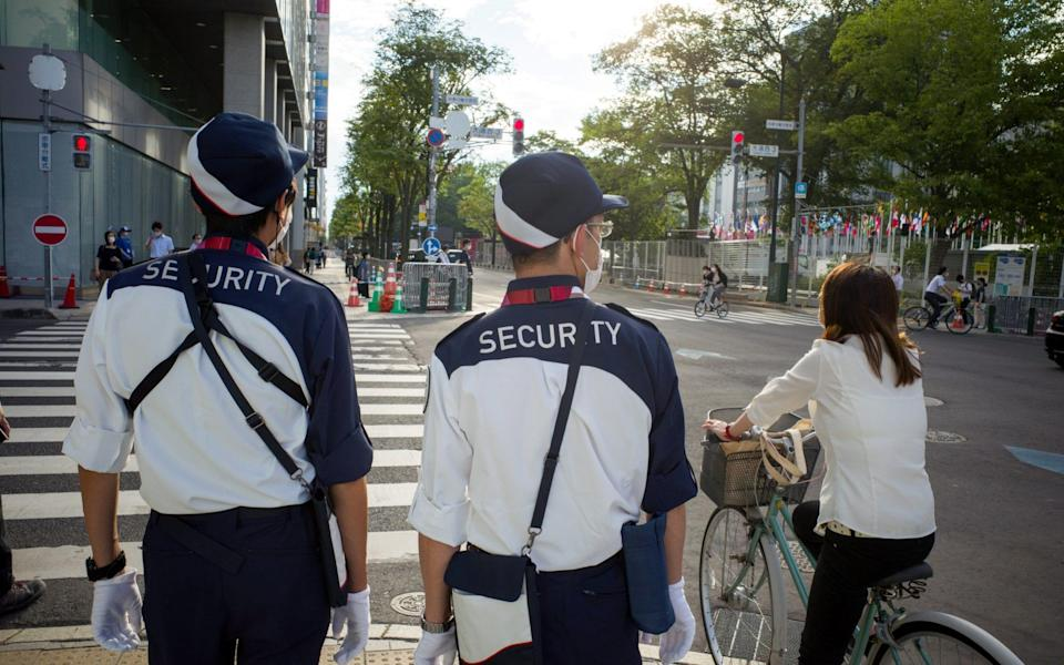 Security officers on patrol in Japan amid a Covid surge - Kentaro Takahashi/Bloomberg