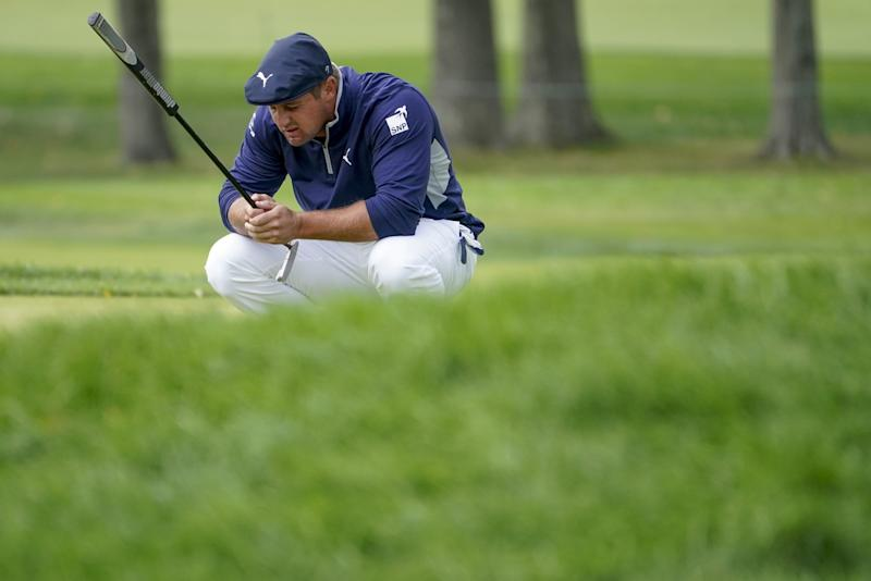 Bryson DeChambeau lines up a putt on the second green during the second round of the U.S. Open on Thursday.