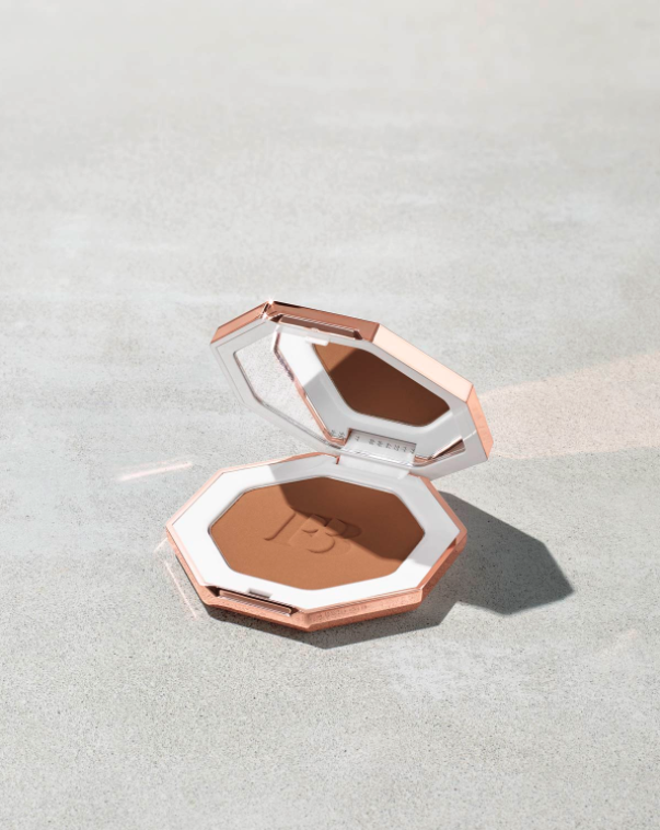 """<p><strong>Fenty Beauty</strong></p><p>fentybeauty.com</p><p><a href=""""https://go.redirectingat.com?id=74968X1596630&url=https%3A%2F%2Fwww.fentybeauty.com%2Fsun-stalkr-instant-warmth-bronzer%2FFB30015.html&sref=https%3A%2F%2Fwww.seventeen.com%2Fbeauty%2Fmakeup-skincare%2Fg35888088%2Ffenty-beauty-sale%2F"""" rel=""""nofollow noopener"""" target=""""_blank"""" data-ylk=""""slk:Shop Now"""" class=""""link rapid-noclick-resp"""">Shop Now</a></p><p><strong><del>$30</del> $22.50 (25% off)</strong></p><p>Fake your way to a sun-kissed glow with the help of RiRi's bronzer.</p>"""