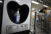 A bottle of hand sanitizer is placed in a subway station for public use to protect against the coronavirus in Seoul, South Korea, Sunday, Dec. 27, 2020. (AP Photo/Lee Jin-man)