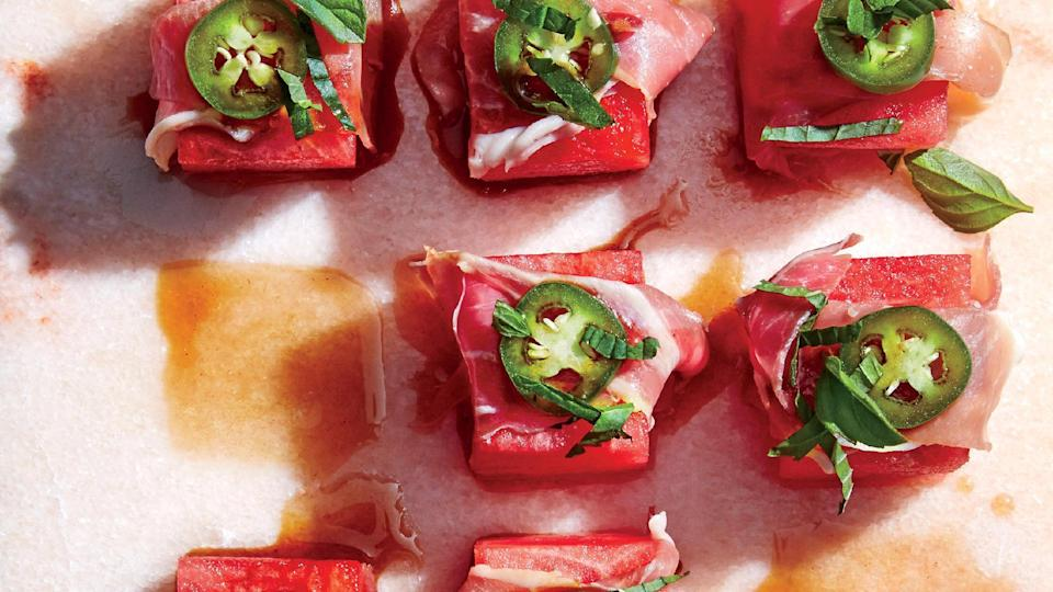 """<p>These bites are a step up from classic prosciutto-wrapped melon and provide sweet, spicy, salty, tart, and meaty tastes. If you can't find serrano ham, use <a href=""""https://www.myrecipes.com/extracrispy/prosciutto-how-to-store"""" rel=""""nofollow noopener"""" target=""""_blank"""" data-ylk=""""slk:prosciutto"""" class=""""link rapid-noclick-resp"""">prosciutto</a>; you also can use balsamic glaze in place of pomegranate molasses.</p>"""