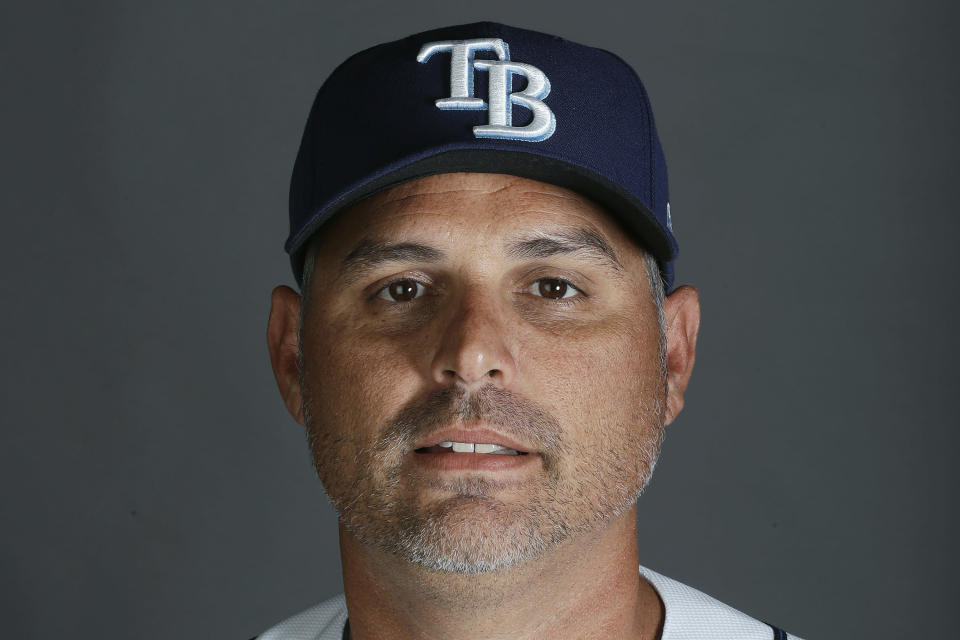 FILE - In this 2020 file photo, Tampa Bay Rays manager Kevin Cash poses for a photo. Cash was named AL manager of the year Tuesday night, Nov. 10, 2020. (AP Photo/John Bazemore, File)