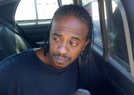 Jefferson County Sheriff Department handout photo shows murder suspect Robinson in the back of a police car after his capture