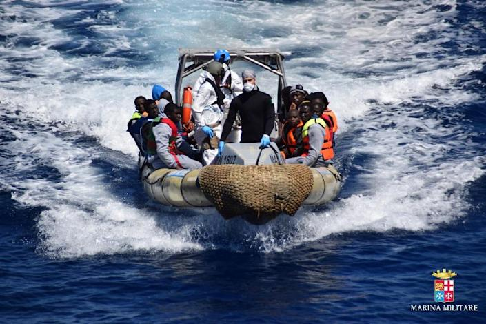 Migrants pictured after being rescued off the coast of Sicily by the Italian Navy on April 11, 2016 (AFP Photo/)