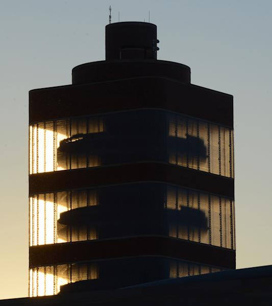This Dec. 9, 2013 photo provided by SC Johnson shows the alternating round and square floors of the SC Johnson Research Tower designed by Frank Lloyd Wright as evening approaches in Racine, Wis. Home products giant SC Johnson is opening the building for public tours for the first time starting May 2. (AP Photo/SC Johnson, Mark Hertzberg)