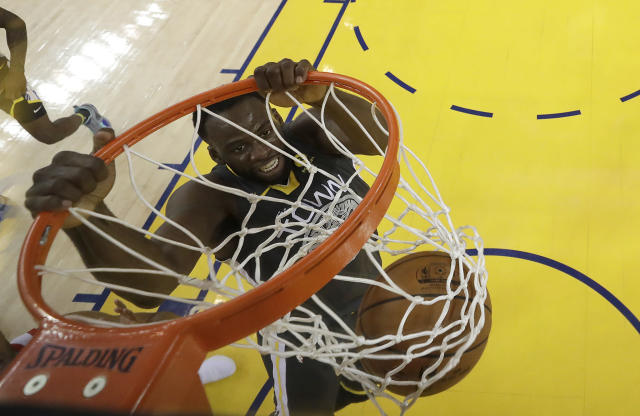 Golden State Warriors forward Draymond Green (23) dunks against the Houston Rockets during the first half in Game 4 of the NBA basketball Western Conference Finals Tuesday, May 22, 2018, in Oakland, Calif. (AP Photo/Marcio Jose Sanchez, Pool)