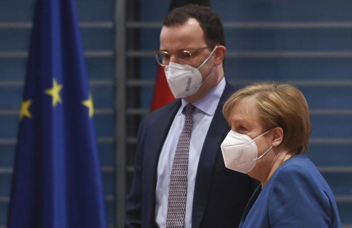 FILE - In this Jan. 6, 2021 file photo, German Chancellor Angela Merkel and Federal Health Minister Jens Spahn arrive at the weekly cabinet meeting wearing face masks in Berlin, Germany. The coronavirus pandemic is colliding with politics as Germany embarks on its vaccination drive and one of the most unpredictable election years in its post-World War II history. (John Macdougall/Pool via AP, File)