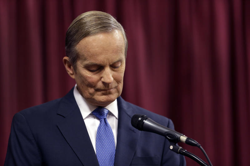 Republican Rep. Todd Akin stands at his podium at the start of the first debate in the Missouri Senate race Friday, Sept. 21, 2012, in Columbia, Mo. (AP Photo/Jeff Roberson)