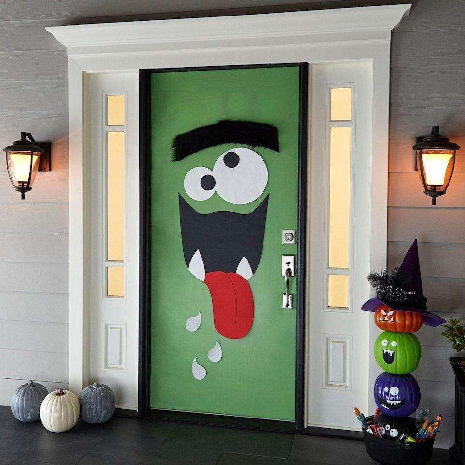 "<p>More funny than frightening, this kooky monster door is perfect for families with youngsters.</p><p><strong>Get the tutorial at <a href=""http://www.michaels.com/monster-door-d%C3%A9cor/B_82014.html?productsource=projects#q=halloween+door&start=1"" rel=""nofollow noopener"" target=""_blank"" data-ylk=""slk:Michaels"" class=""link rapid-noclick-resp"">Michaels</a>.</strong></p><p><a class=""link rapid-noclick-resp"" href=""https://www.amazon.com/Pacon-PAC67144-Kraft-Duo-Finish-Emerald/dp/B00006IE1H/?tag=syn-yahoo-20&ascsubtag=%5Bartid%7C10050.g.22350299%5Bsrc%7Cyahoo-us"" rel=""nofollow noopener"" target=""_blank"" data-ylk=""slk:SHOP GREEN PAPER"">SHOP GREEN PAPER</a><br></p>"