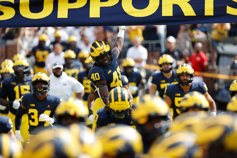 Michigan players take the field prior to the game against Northern Illinois.