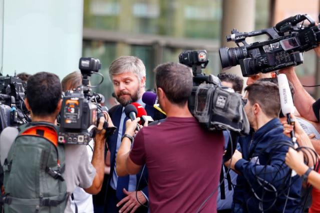 German Rodriguez, lawyer for Brazilian soccer player Neymar speaks with media members after he appeared before a judge in a case against Neymar's former club FC Barca in Barcelona