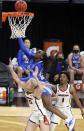 UCLA forward Michaela Onyenwere (21) shoots over Arizona forward Cate Reese (25) during the second half of an NCAA college basketball game in the semifinals of the Pac-12 women's tournament Friday, March 5, 2021, in Las Vegas. (AP Photo/Isaac Brekken)