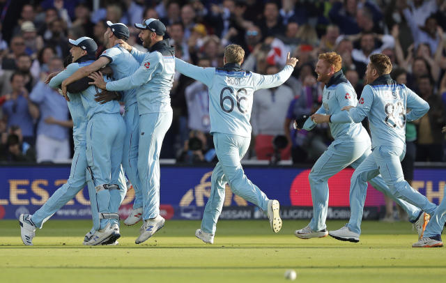 England players mob Jofra Archer after he bowled the super over to win the Cricket World Cup final. (AP Photo/Matt Dunham)