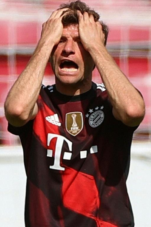 Bayern Munich forward Thomas Mueller shows his frustration after defeat at Mainz