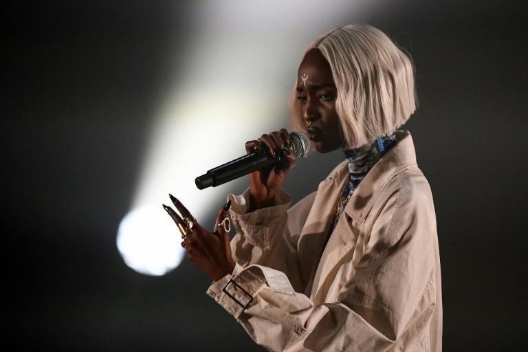 """Lous and The Yakuza, the stage-name of Belgium-based rapper Marie-Pierra Kakoma, says she wants """"to shine a light on evil -- otherwise we don't heal"""""""