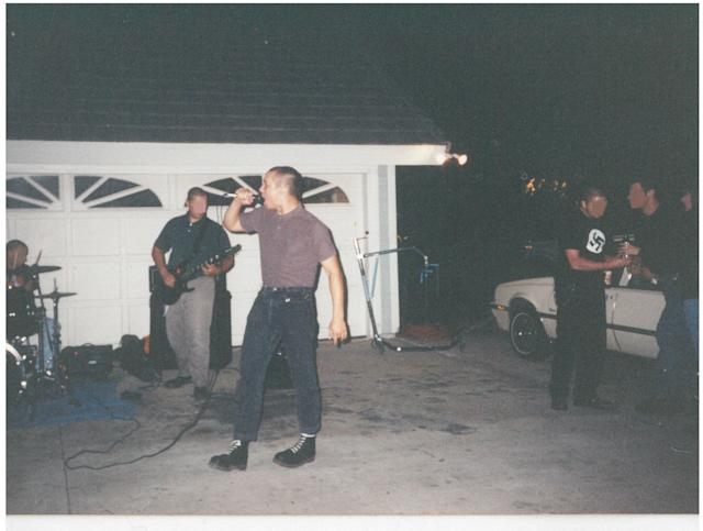 "Chuck Leek performs with Battle Axe, which he calls a ""white power-skinhead band,"" in a driveway. (Photo: Chuck Leek)"