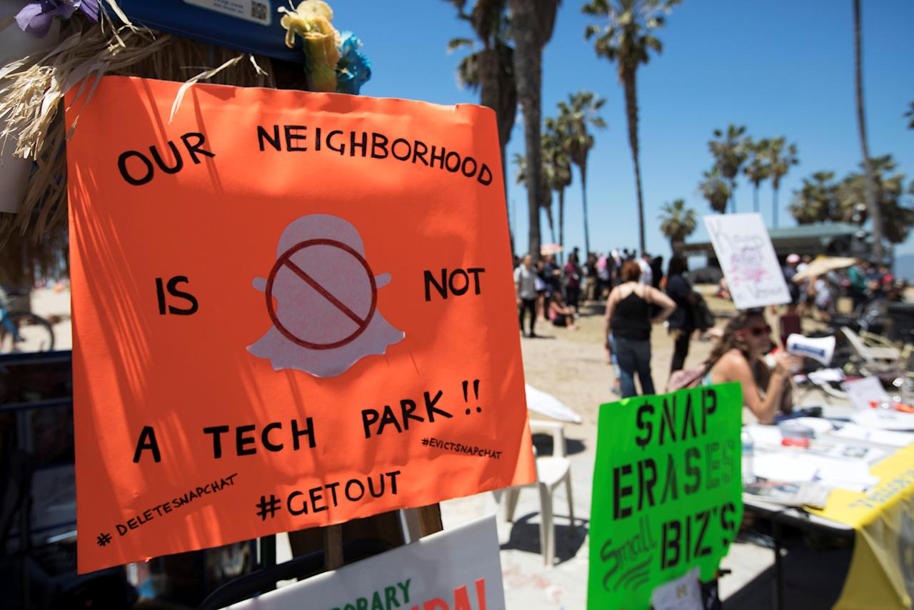 Protest signs against Snapchat are seen during the Venice Beach Freakshow final performance and rent rise protest party on Venice Beach, Los Angeles, California, U.S., April 30, 2017. REUTERS/Monica Almeida