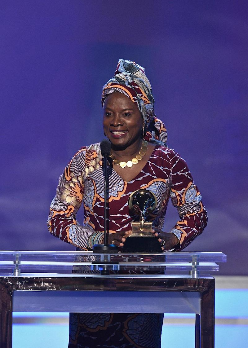 Winner for Best World Music Album Angelique Kidjo addresses the crowd on stage at the 57th Annual Grammy Awards in Los Angeles February 8, 2015