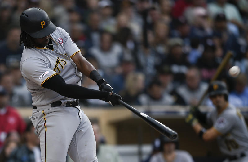 Pittsburgh Pirates' Josh Bell hits a three-run home run off a pitch by San Diego Padres' Nick Margevicius during the third inning of a baseball game in San Diego, Saturday, May 18, 2019. (AP Photo/Kelvin Kuo)
