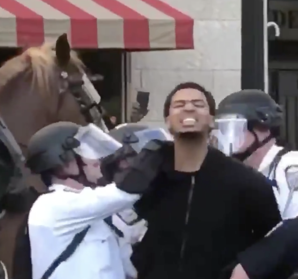 """Seth Towns continued to shout, """"Say his name!"""" as Columbus police detained him. (Twitter)"""
