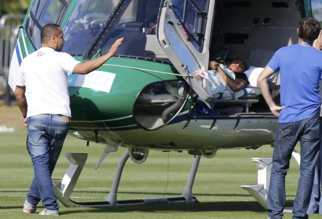 Brazil's Neymar waits to be airlifted home from Brazil's training camp inTeresopolis near Rio de Janeiro July 5, 2014. REUTERS/Marcelo Regua (BRAZIL - Tags: SOCCER SPORT WORLD CUP)
