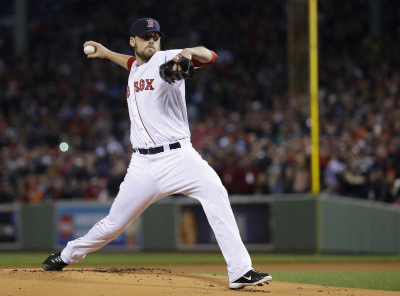 Boston Red Sox starting pitcher John Lackey throws during the first inning of Game 2 of baseball's World Series against the St. Louis Cardinals Thursday, Oct. 24, 2013, in Boston. (AP Photo/Matt Slocum)
