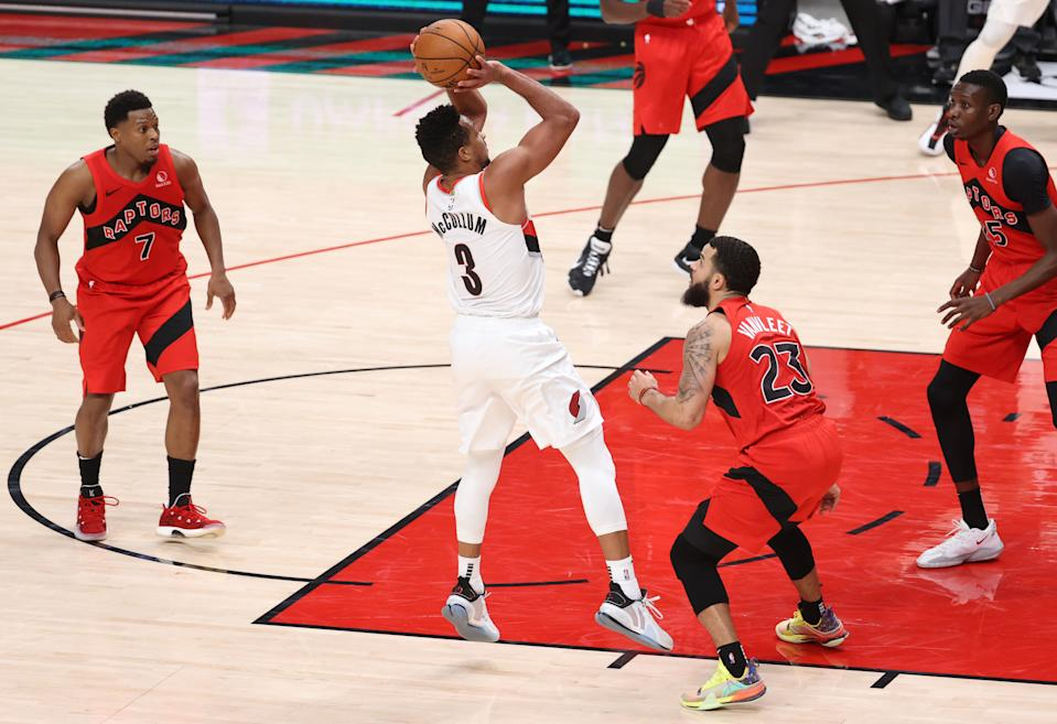 CJ McCollum shoots the game-winning shot over Fred VanVleet.