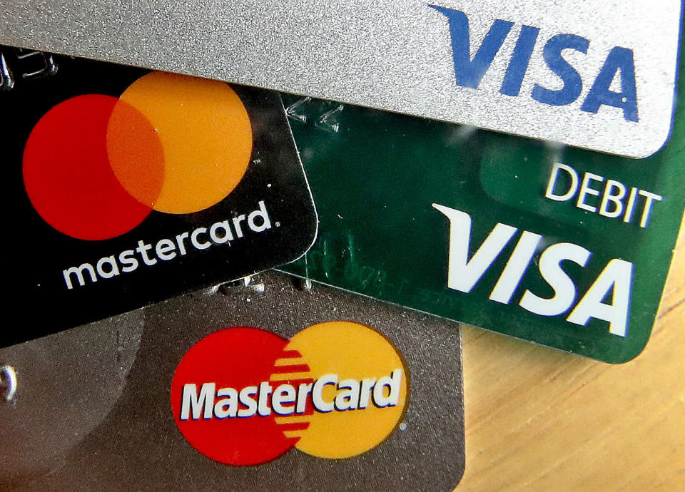 FILE - In this Feb. 20, 2019, file logos for credit cards are visible on the cards in Zelienople, Pa. On Friday, June 7, the Federal Reserve releases its April report on consumer borrowing. (AP Photo/Keith Srakocic, File)